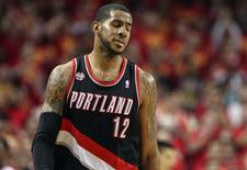 Apr 30, 2014; Houston, TX, USA; Portland Trail Blazers forward LaMarcus Aldridge (12) reacts after a play during the fourth quarter against the Houston Rockets in game five of the first round of the 2014 NBA Playoffs at Toyota Center. The Rockets defeated the Trail Blazers 108-98. Mandatory Credit: Troy Taormina-USA TODAY Sports
