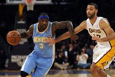 Jan 5, 2014; Los Angeles, CA, USA; Denver Nuggets guard Ty Lawson (3) drives the ball defended by Los Angeles Lakers guard Kendall Marshall (12) during the first period at Staples Center. Mandatory Credit: Kelvin Kuo-USA TODAY Sports