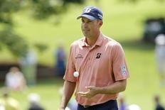 Sep 11, 2014; Atlanta, GA, USA; Matt Kuchar tosses his ball after the second hole during the first round of the Tour Championship at East Lake Golf Club. Mandatory Credit: Brett Davis-USA TODAY Sports