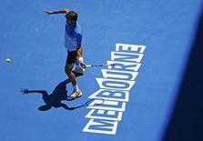 Feliciano Lopez of Spain hits a return to Jerzy Janowicz of Poland during their men's singles third round match at the Australian Open 2015 tennis tournament in Melbourne January 24, 2015. Lopez defeated Janowicz to win the match.   REUTERS/Issei Kato