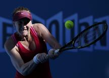 Madison Brengle of the U.S. hits a return against Coco Vandeweghe of the U.S. during their women's singles third round match at the Australian Open 2015 tennis tournament in Melbourne January 24, 2015. REUTERS/Athit Perawongmetha