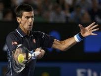 Novak Djokovic of Serbia hits a return against Fernando Verdasco of Spain during their men's singles third round match at the Australian Open 2015 tennis tournament in Melbourne January 24, 2015. REUTERS/Thomas Peter
