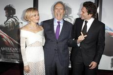 "Actress Sienna Miller (L), director Clint Eastwood and actor Bradley Cooper ( R) arrive for the premiere of the film ""American Sniper"" in New York, December 15, 2014.  REUTERS/Carlo Allegri"