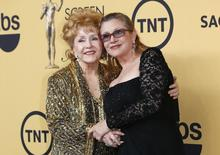 Actress Debbie Reynolds poses with her daughter actress Carrie Fisher backstage after accepting her Lifetime Achievement award at the 21st annual Screen Actors Guild Awards in Los Angeles, California January 25, 2015.  REUTERS/Mike Blake