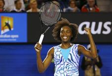 Venus Williams of the U.S. celebrates defeating Agnieszka Radwanska of Poland in their women's singles fourth round match at the Australian Open 2015 tennis tournament in Melbourne January 26, 2015.     REUTERS/Issei Kato