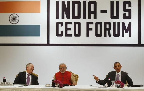Honeywell CEO Dave Cote (L) and India's Prime Minister Narendra Modi (C) laugh at a remark by U.S. President Barack Obama (R) during a CEO Roundtable and Forum at the India U.S. Business Summit in New Delhi January 26, 2015. REUTERS-Jim Bourg