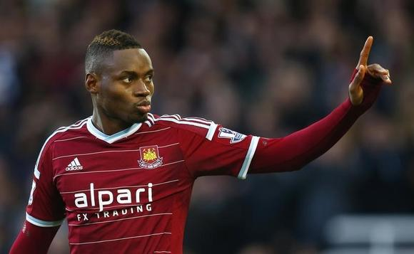 Diafra Sakho of West Ham United celebrates scoring his team's third goal against Swansea City during their English Premier League soccer match at Upton Park in London, December 7, 2014.   REUTERS/Eddie Keogh