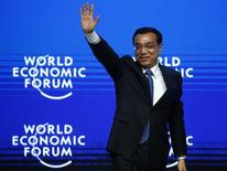 China's Premier Li Keqiang waves to listeners after his speech during The Global Impact of China's Economic Transformation event in the Swiss mountain resort of Davos January 21, 2015. REUTERS/Ruben Sprich
