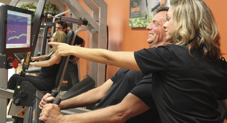 Clients work out at The Exercise Coach in Houston, Texas, June 18, 2014, in this handout photo provided by The Exercise Coach on January 23, 2015.   REUTERS/The Exercise Gym/Handout via Reuters