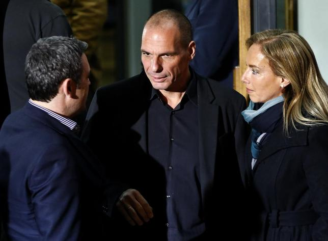 Greek economist Yanis Varoufakis (C) is seen outside the Syriza party headquarters in Athens, late January 25, 2015. REUTERS/Alkis Konstantinidis