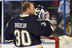 Dec 8, 2014; St. Louis, MO, USA; St. Louis Blues goalie Martin Brodeur (30) kisses the back of his helmet before the game between the St. Louis Blues and the Florida Panthers at Scottrade Center. Mandatory Credit: Jasen Vinlove-USA TODAY Sports