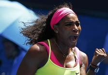 Serena Williams of the U.S. celebrates winning a point over Dominika Cibulkova of Slovakia during their women's singles quarter-final match at the Australian Open 2015 tennis tournament in Melbourne January 28, 2015. REUTERS/Issei Kato