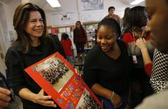 Opera singer Ana Maria Martinez (L) receives a gift from students at Lake View High School in Chicago, Illinois, October 22, 2014. REUTERS/Jim Young