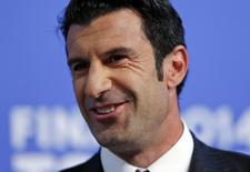 Luis Figo smiles during the draw for the Champions League semi-finals matches at the UEFA headquarters in Nyon, April 11, 2014. REUTERS/Denis Balibouse