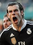 Real Madrid's Gareth Bale celebrates after scoring against Cordoba during their Spanish First Division soccer match at El Arcangel stadium in Cordoba, January 24, 2015. REUTERS/Marcelo del Pozo (SPAIN - Tags: HEADSHOT SPORT SOCCER)