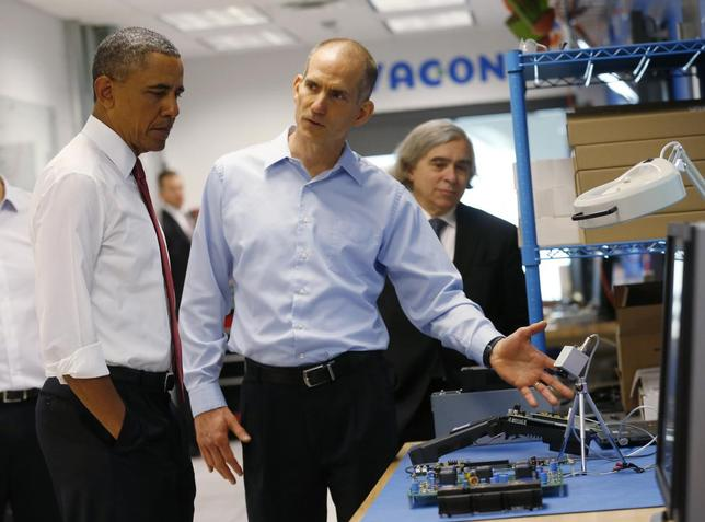 President Obama listens to engineer Rod Washington as he tours Vacon, a company that manufactures AC drives, during a visit to Raleigh, North Carolina, January 15, 2014.  REUTERS/Kevin Lamarque