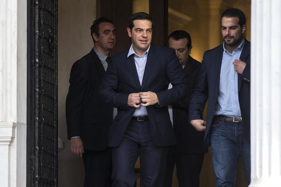 Newly appointed Greek Prime Minister and winner of the Greek parliamentary elections, Alexis Tsipras (2nd L), walks with members of his cabinet in Athens, January 27, 2015.  REUTERS/Marko Djurica