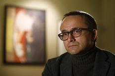 Director Andrey Zvyagintsev listens to a question of a journalist in Moscow December 24, 2014.  REUTERS/Sergei Karpukhin
