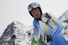 Bode Miller of the U.S. is seen in front of the famous Eiger Northface (L) before the start to the men's Alpine Skiing World Cup Downhill training in Wegen January 15, 2015.    REUTERS/Denis Balibouse