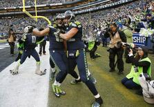 January 18, 2015; Seattle, WA, USA; Seattle Seahawks wide receiver Jermaine Kearse (15) celebrates with tight end Luke Willson (82) after catching the game winning touchdown pass against the Green Bay Packers during the overtime period for the 28-22 victory in the NFC Championship game at CenturyLink Field. Mandatory Credit: Joe Nicholson-USA TODAY Sports