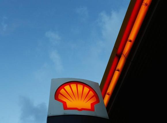 A Shell logo is seen at a petrol station in London January 31, 2013. REUTERS/Luke MacGregor/Files