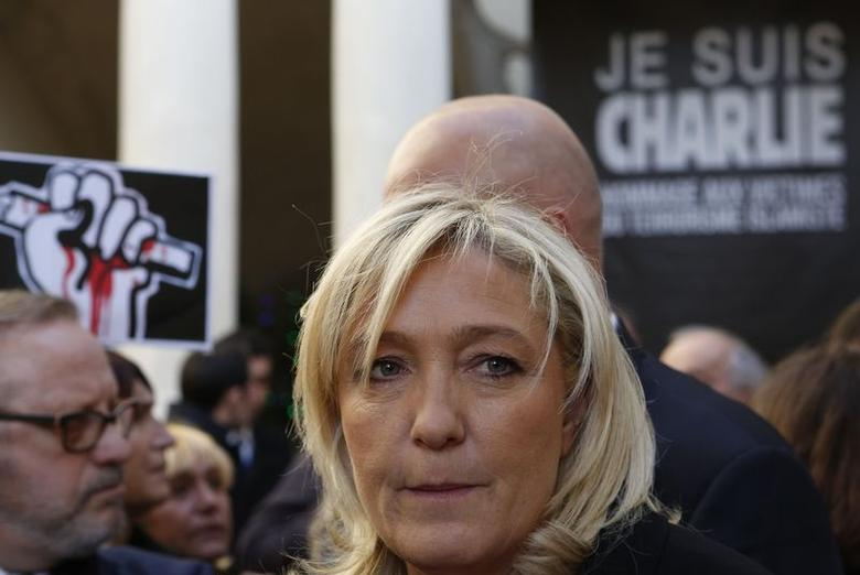 France's far-right National Front political party leader Marine Le Pen attends a gathering in front of the town hall in Beaucaire, paying tribute to the victims of the shooting by gunmen at the offices of the satirical weekly newspaper Charlie Hebdo, January 11, 2015. REUTERS/Philippe Laurenson