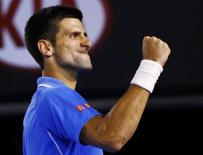 Novak Djokovic of Serbia celebrates after defeating Stan Wawrinka of Switzerland in their men's singles semi-final match at the Australian Open 2015 tennis tournament in Melbourne January 30, 2015. REUTERS/Issei Kato