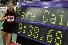 Mary Cain poses for a photo next to her record for the high school girls two mile during the New Balance Indoor Grand Prix track meet in Boston, Massachusetts, February 2, 2013. REUTERS/Jessica Rinaldi