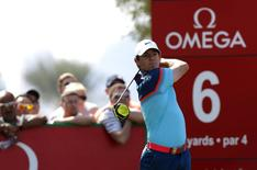 Rory McIlroy of Northern Ireland tees off on the sixth hole during the final round of the Dubai Desert Classic February 1, 2015. REUTERS/Fadi Al-Assaad