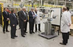 """Canada's Prime Minister Stephen Harper views a robot that wrote """"Canada"""" and drew a maple leaf at electronics manufacturing services company Celestica in Toronto in this file photo taken on December 4, 2014.  REUTERS/Mark Blinch"""
