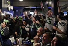 Seattle Seahawks fans react to a touchdown in the first half as they watch the Super Bowl XLIX at the Hawks Nest bar in Seattle, Washington February 1, 2015. REUTERS/Jason Redmond