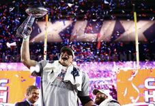 Feb 1, 2015; Glendale, AZ, USA; New England Patriots tight end Rob Gronkowski hoists the Vince Lombardi Trophy after defeating the Seattle Seahawks in Super Bowl XLIX at University of Phoenix Stadium. Mark J. Rebilas-USA TODAY Sports