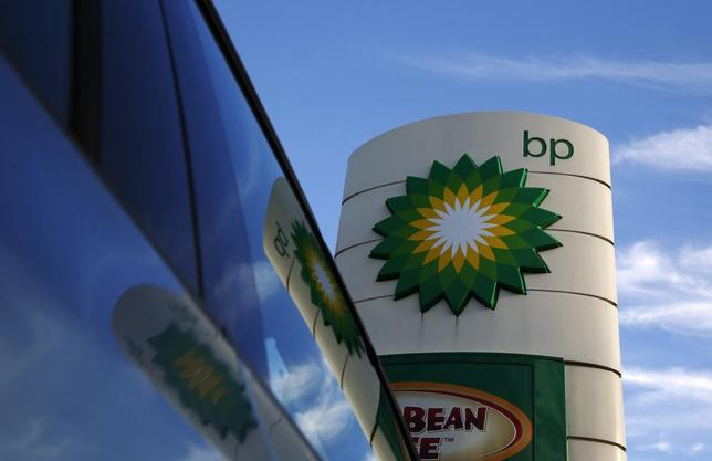 A BP logo is reflected in a car window at a petrol station in London January 15, 2015.  REUTERS/Luke MacGregor