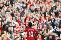 Coutinho comemora gol do Liverpool contra o Tottenham Hotspur. 30/03/2014. REUTERS/Phil Noble