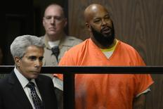 Rap mogul Suge Knight is pictured with attorney David E. Kenner (L) in court during his arraignment on murder charges at the Compton Courthouse in Compton, California February 3, 2015.  REUTERS/Paul Buck