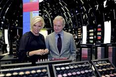Fabrizio Freda (R), President and CEO, The Estee Lauder Companies, and Karen Buglisi (L), Global Brand President, M.A.C Cosmetics, pose in the M.A.C shop in Paris, February 28, 2013.REUTERS/Philippe Wojazer