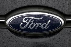 The Ford logo is pictured at the Ford Motor Co plant in Genk December 17, 2014. In 2012 Ford announced that production of the models made in Genk would move to Valencia, Spain, with the loss of 4,300 jobs at the Belgian site.    REUTERS/Francois Lenoir (BELGIUM - Tags: BUSINESS LOGO EMPLOYMENT TRANSPORT)