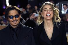 "Actor Johnny Depp and girlfriend Amber Heard laugh as they arrive for the UK premiere of ""Mortdecai"" at Leicester Sqaure in London January 19, 2015.  REUTERS/Luke MacGregor"