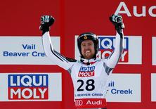 Feb 5, 2015; Beaver Creek, CO, USA; Dustin Cook of Canada celebrates at the flower ceremony after placing second in the men's Super G in the FIS alpine skiing world championships at Birds of Prey Racecourse. Mandatory Credit: Jeff Swinger-USA TODAY Sports