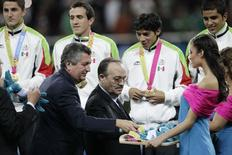 Mexico's players receive their gold medals from Pan American Sports Organization president Mario Vasquez Rana (2nd R) and Jorge Vergara (L), owner of the Guadalajara Chivas soccer team and Omnilife Stadium, after Mexico won their men's soccer final against Argentina at the Pan American Games at the Omnilife Stadium in Guadalajara in this October 28, 2011 file photograph. REUTERS/Henry Romero/Files