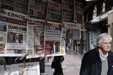 Greek Prime Minister Alexis Tsipras is pictured on newspapers at a kiosk in Athens February 9, 2015. REUTERS/Alkis Konstantinidis