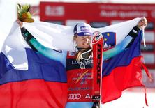 Feb 9, 2015; Beaver Creek, CO, USA; Tina Maze of Slovenia celebrates at the flower ceremony after winning the women's alpine combined in the FIS alpine skiing world championships at Raptor Racecourse. Mandatory Credit: Jeff Swinger-USA TODAY Sports