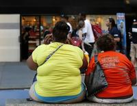 Women sit on a bench in New York's Times Square in this file photo taken on May 31, 2012. REUTERS/Brendan McDermid