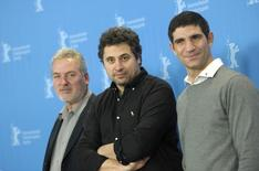 """Actor Teodor Corban, director Radu Jude and actor Toma Cuzin (L-R) pose during a photo call to promote the in-competition film """"Aferim! """"at the 65th Berlinale International Film Festival in Berlin February 11, 2015. REUTERS/Stefanie Loos"""