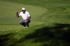 Feb 5, 2015; La Jolla, CA, USA; Tiger Woods lines up his putt on the 18th during the first round of the Farmers Insurance Open golf tournament at Torrey Pines Municipal Golf Course - North Course. Mandatory Credit: Jake Roth-USA TODAY Sports