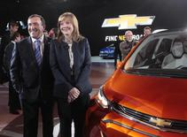 General Motors CEO Mary Barra and Alan Batey, President of GM North America, pose next to the Chevrolet Bolt EV electric concept car after it was unveiled during the first press preview day of the North American International Auto Show in Detroit, Michigan January 12, 2015. REUTERS/Rebecca Cook