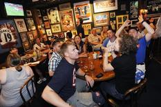 Fans react as they watch the 2010 World Cup soccer match between the U.S. and England via television from South Africa, at Bugsy's Sports Bar in Alexandria, Virginia, in this file photo taken on June 12, 2010. REUTERS/Jonathan Ernst