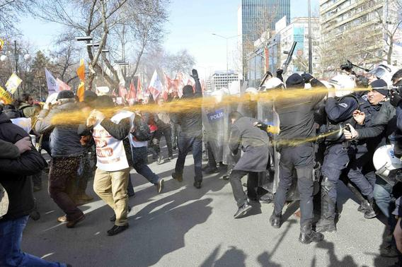 Police use tear gas to disperse scores of protesters boycotting schools over the growing influence of religion in the classroom in Ankara February 13, 2015. REUTERS-Stringer