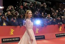 Actress Lily James arrives for the screening of the movie 'Cinderella' at the 65th Berlinale International Film Festival in Berlin February 13, 2015.   REUTERS/Stefanie Loos