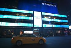 The Barclays logo is brightly lit on their building in Times Square, Manhattan, New York in the early hours of January 18, 2015. REUTERS/Carlo Allegri